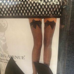 Black bow thigh high fishnets